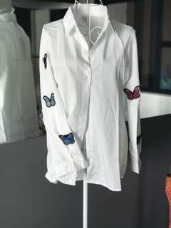 White shirt with butterflies