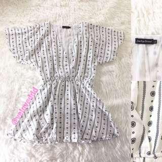 *Something borrowed white print wrap dress