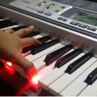 Casio 61 keys piano keyboard (LK-100 model)