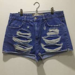 High-waisted ripped shorts