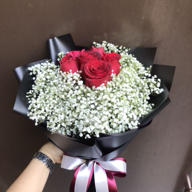 6 red roses and baby breath bouquet