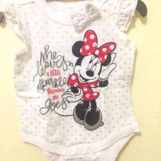 For sale Minnie Mouse body suit. Size 3 months to 6 months. The writings are cute.