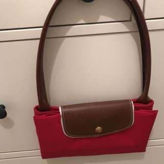 Red longchamp bag
