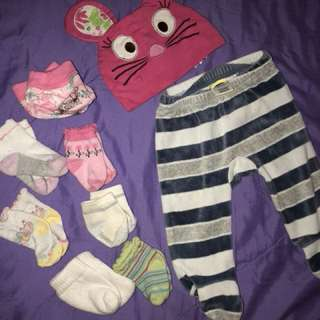 A package of 9 Baby items (socks, hat & old navy bottom pant)