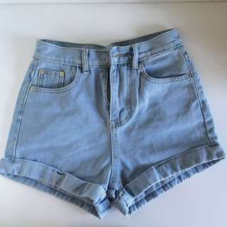 high waisted light blue denim shorts cuffed