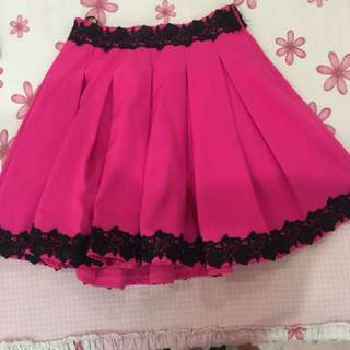 hot pink skirt with black flower detail