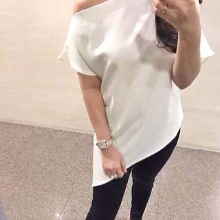 One sided sleeveless white top