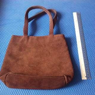 Velvet like material brown handbag