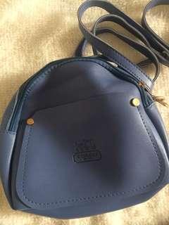 Coach inspired sling bag /backpack