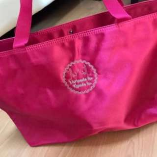 Brand new pink handbag with snap button