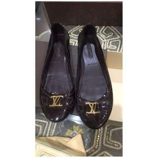 Louis Vuitton flats.