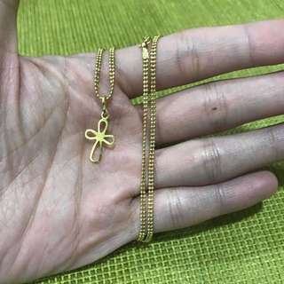 18 karat cross necklace with 2-layer beaded chain. Chain is 3.5 grams pendant is 0.5 grams