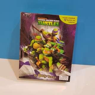 Teenage Mutant Ninja Turtles children's book with figures