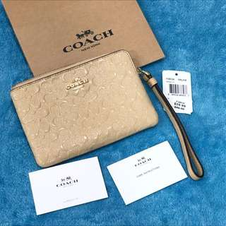 USA Coach F58034 Corner Zip Wristlet Signature Debossed Patent Leather Platinum