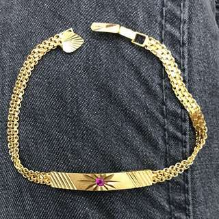 21 karat ID bracelet with pink stone and 1 heart charm 8.8 grams hallmark 21K HAS