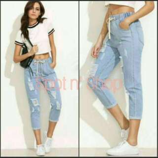 Garterized ripped tattered jeans
