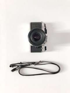 #15Off Nikon SLR FM2 with lens