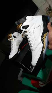 Nike jordan 5 olympic gold tongue
