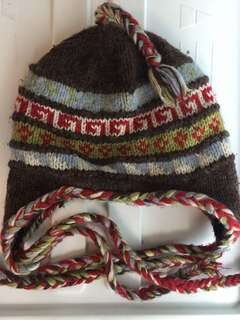 Tuque with side braids fleece lined