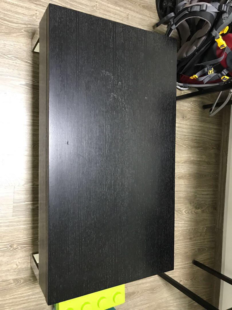 Coffee table with raise-able table top
