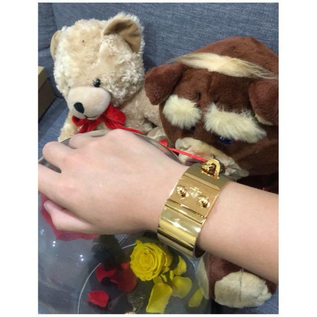 Louis Vuitton gold bracelet.