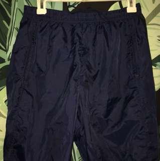 Dark blue Nike track pants