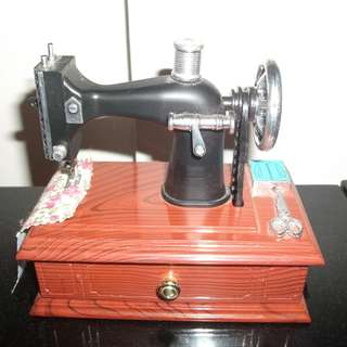 Musical sewing machine model movable parts