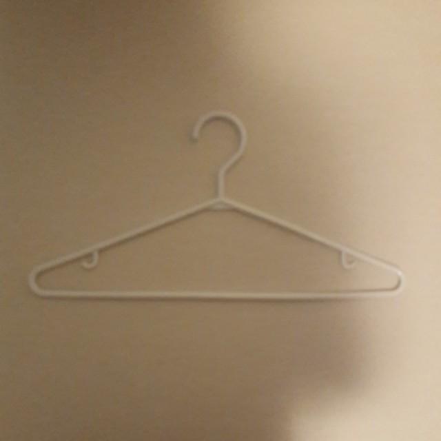 10 White Plastic Hangers