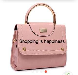 Handbag with sling strap