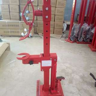 Damping spring disassembling   Machine    CAST BRACKET model 40524.