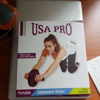 New unused Ab Roller for toning