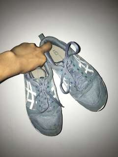 Blue Asics sports shoes