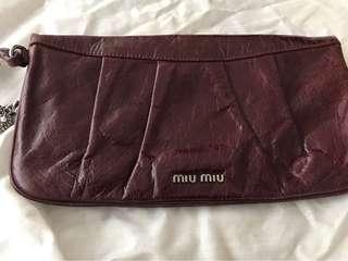 Miu Miu dark purple bag