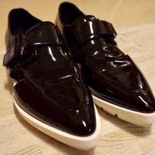Black and white leather shoes