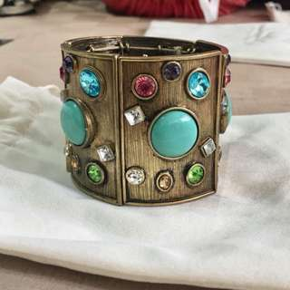 Brand new Egyptian vintage gold with gemstone statement bangle