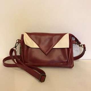 Red white sling bag