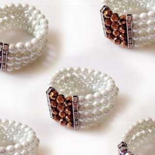 Brand new pearl strand with faceted beads bangle bracelet