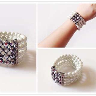 Brand new pearl strand with silver faceted beads bangle bracelet