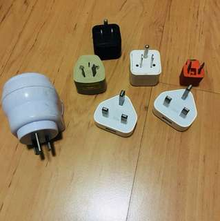 Assorted iphone plugs & travel adaptors - lot of 7