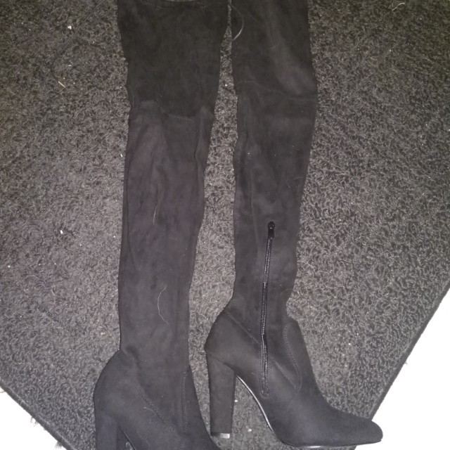 Black thigh high heel boots