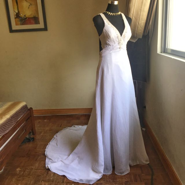 Long trail white deep v gown for rent or sale