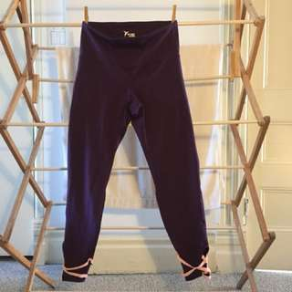 Dark purple sports leggings w/ light pink elastics at ankles