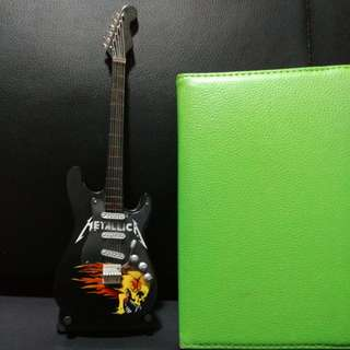 Metallica Miniature guitar for display comes with stand. Not a real guitar