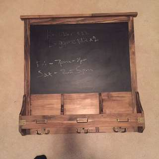 Wooden chalkboard with hooks