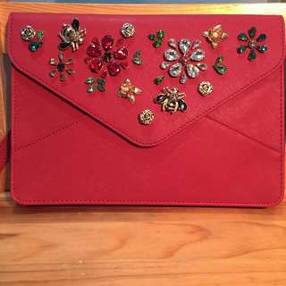 Red embellished clutch