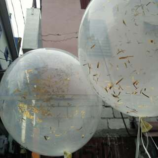 flying balloons with confetti