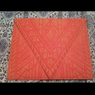 Pink envelope style clutch