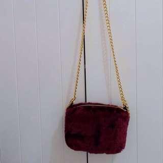 Maroon fur sling bag