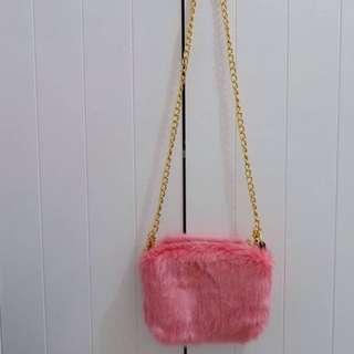 Pink faux fur sling bag