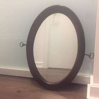 Oval brown wooden framed mirror